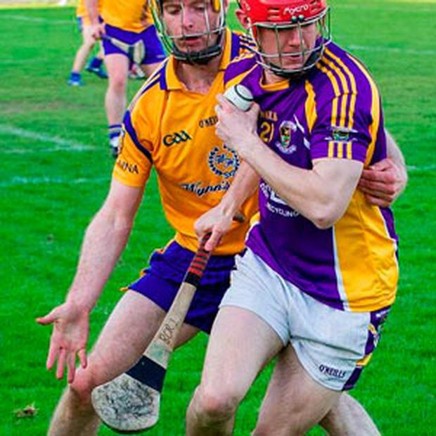 MISSING HURLEY: Kilmacud Crokes' Barry O'Rorke gets away from Na Fianna's Martin Quilty during their Dublin SHC match at Parnell Park.