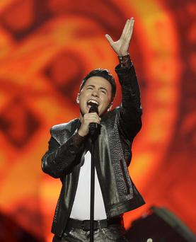 Ryan Dolan of Ireland performs his song Only Your Love Survives during the final of the Eurovision Song Contest at the Malmo Arena in Malmo, Sweden