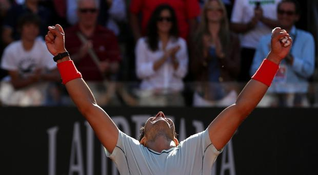 Rafael Nadal of Spain celebrates after winning the men's singles final match against Roger Federer of Switzerland at the Rome Masters tennis tournament