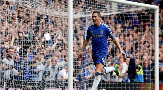 Chelsea's Fernando Torres celebrates after scoring against Everton on the last day of last season