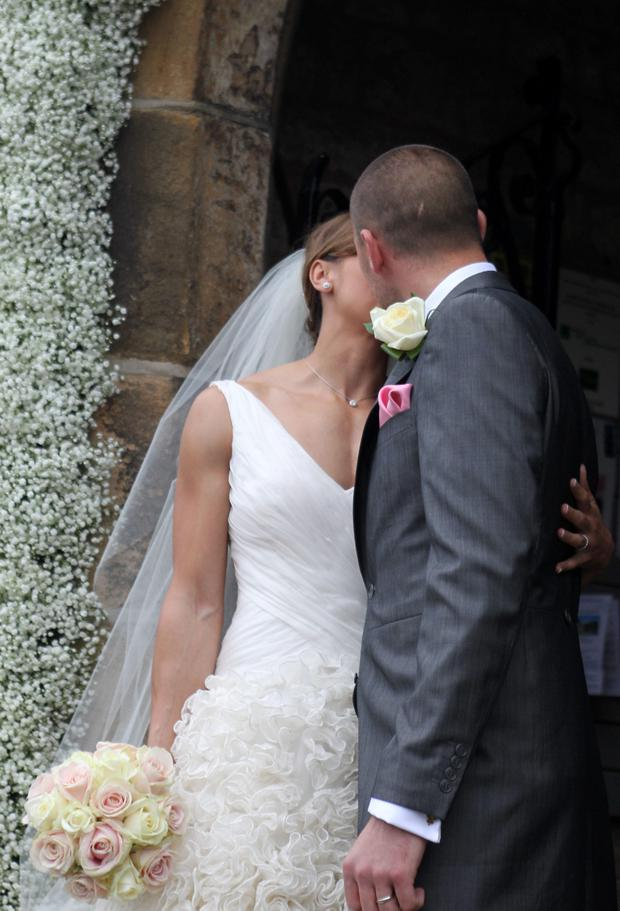 Olympic Gold medalist Jessica Ennis and Andy Hill kiss following their wedding at St Michael and All Angels Church, Hathersage, Derbyshire.