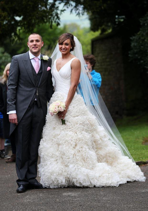 Olympic Gold medalist Jessica Ennis pose for the waiting media after she married Andy Hill in St Michael and All Angels Church, Hathersage, Derbyshire. PRESS ASSOCIATION Photo. Picture date: Saturday May 18, 2013. Photo credit should read: Lynne Cameron/PA Wire