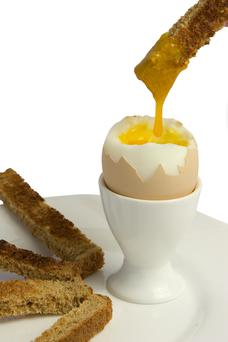 Two boiled eggs with one slice of wholegrain toast for breakfast