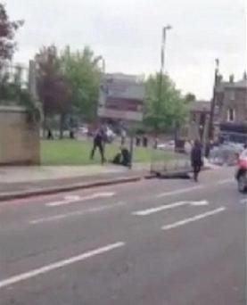 Screengrab courtesy of @woolwichfinest of the scene at the junction of John Wilson Street and Wellington Street in Woolwich were a man was murdered in a terror attack.