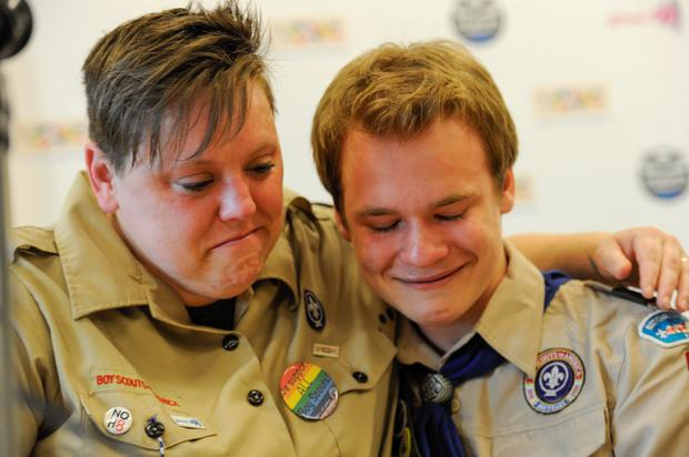 Jennifer Tyrrell (L), who was removed from her position as a den leader in 2012 for being gay, hugs Pascal Tessier, 16, after a resolution passed to allow openly gay scouts in the Boy Scouts of America at the Boy Scouts' National Annual Meeting in Grapevine, Texas