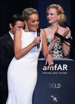 Sharon Stone and Nicole Kidman at amfAR's 20th Annual Cinema Against AIDS auctioning the Leonardo Di Caprio space seats