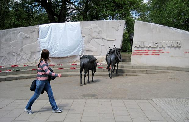 A tarpaulin covers part of the Animals in War Memorial on Park Lane in central London, after it and the RAF Bomber Command War Memorial was daubed with graffiti.