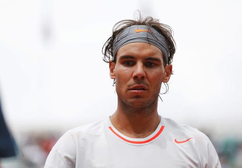 Rafael Nadal of Spain reacts during his men's singles match against Daniel Brands of Germany at the French Open tennis tournament at the Roland Garros stadium in Paris May 27, 2013. REUTERS/Vincent Kessler (FRANCE - Tags: SPORT TENNIS HEADSHOT)