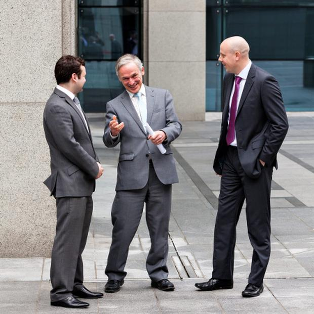 Oliver Gabbay, Chief Operating Officer of Aztec Money, with Minister for Jobs, Enterprise and Innovation, Richard Bruton TD, and Colm Devine, VP of Business Development at Aztec Money.