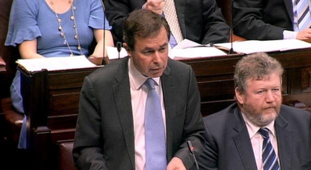 Justice Minister Alan Shatter speaking in the Dail, flanked by health minister James Reilly