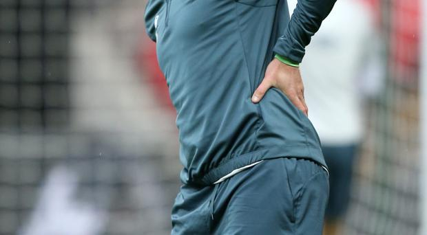 Republic of Ireland's Richard Dunne stretches during a training session. Walton/PA Wire.