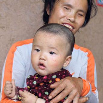 Du Xiurong, from Shibei in Mianyang, southwest China, with her grandson.