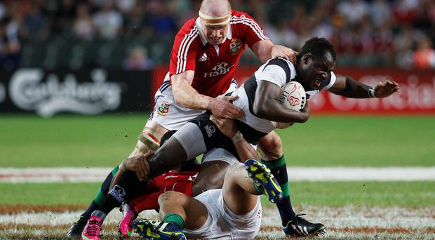 Barbarians' Takudzwa Ngwenya (R) is tackled by British and Irish Lions captain Paul O'Connell