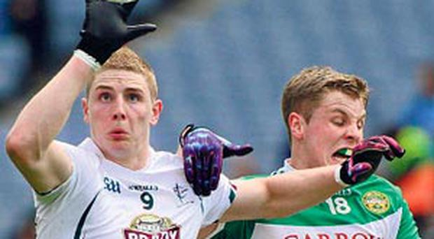 Kildare's Daniel Flynn battles for the ball with Johnny Moloney
