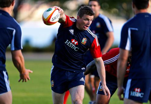 Brian O'Driscoll runs with the ball during a training session in Perth