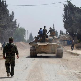 Forces of Syrian President Bashar al-Assad are seen in Arjoun village near Qusair town over the weekend. Photo: Reuters
