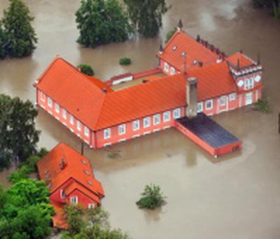 Aerial view of the swollen Vltava river's flooded Red Mill at chateau park in Veltrusy, about 35 km north of Prague