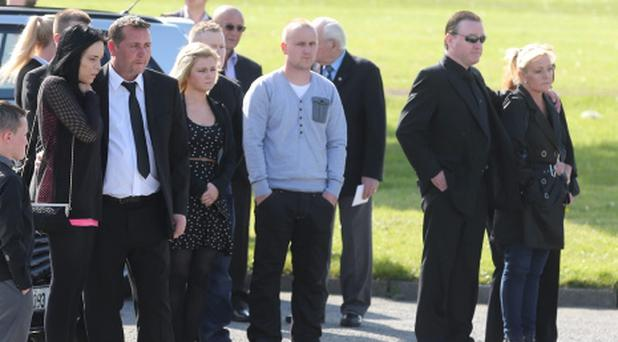 Dean's girlfriend Sarah O'Rourke, and father Christopher, and mother Audrey Fitzpatrick (right), at the removal service for the young man who who was stabbed to death. Photo: Arthur Carron/Collins
