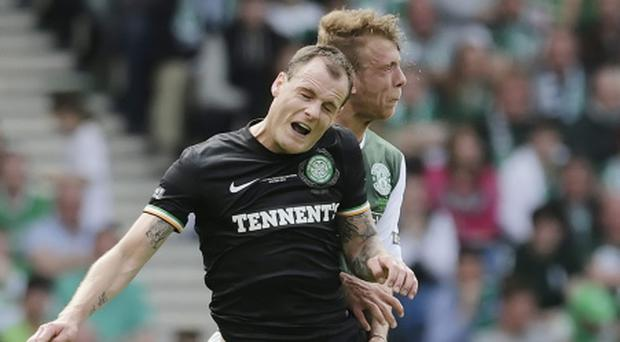 Celtic's Anthony Stokes fights for the ball with Jordon Foster of Hibernian Photo: PA
