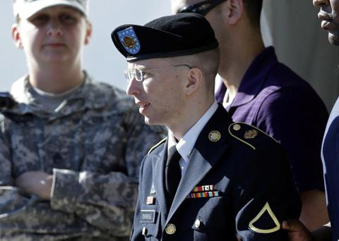 Army Pfc. Bradley Manning, front, is escorted out of a courthouse in Fort Meade