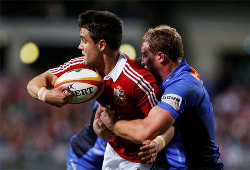 Connor Murray (L) is tackled by Brett Sheehan