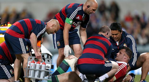 Cian Healy is treated on the pitch after sustaining an injury during the game
