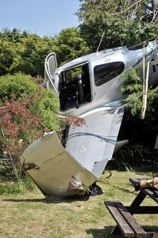 The Cirrus single-engine aircraft after it made a dramatic crash-landing in a back garden in Cheltenham, Gloucestershire