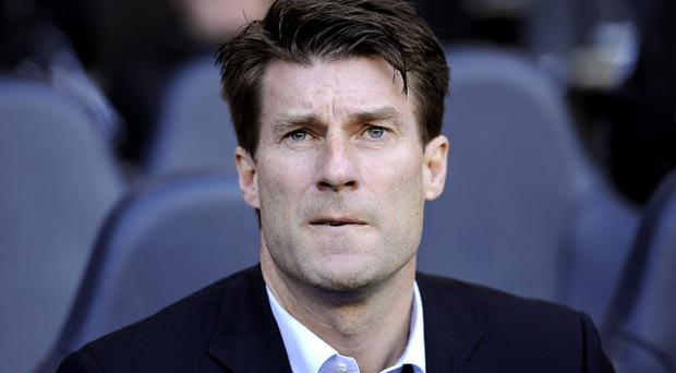 A disagreement over transfer funds is threatening to disrupt Swansea's summer plans but manager Michael Laudrup is expected to still be in charge of the club next season. Jonathan Brady/PA Wire.