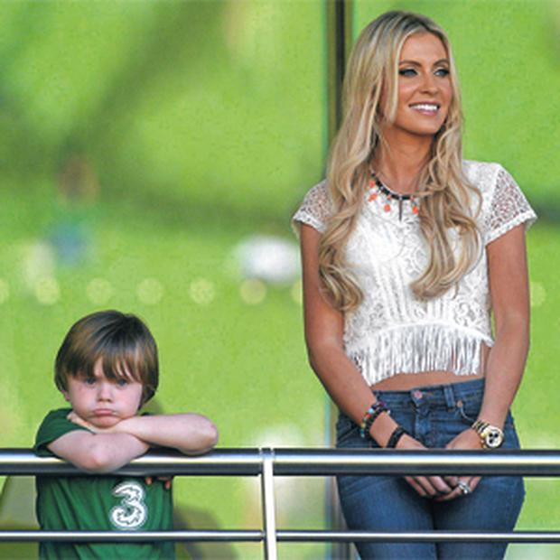 Robbie Keane's wife Claudine and their son Robbie Junior watched the Republic of Ireland captain not only become the country's most-capped player but also manage to score all three goals as his side beat the Faroe Islands 3 - 0 at the Aviva Stadium.