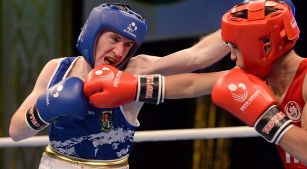 Paddy Barnes, left, Ireland, exchanges punches with Salman Alizada, Azerbaijan, during their 49Kg Light Flyweight semi-final bout