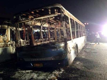 This image made with a mobile phone camera released by China's Xinhua News Agency shows the remains of an express bus that burst into flames in Xiamen