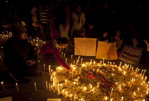 Indians light candles as they mourn the death of a gang rape victim in New Delhi, India. The woman's death sparked a wave of protests like this one