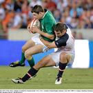 Felix Jones is tackled by Seamus Kelly, USA