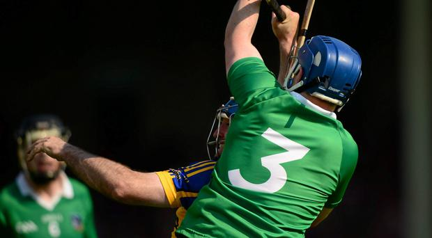 Limerick full back Richie McCarthy wins possession ahead of Tipperary's Eoin Kelly late in the game.