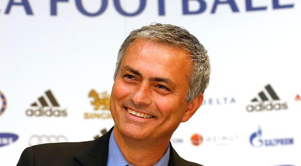 Newly reappointed Chelsea manager Jose Mourinho reacts during a news conference at Stamford Bridge stadium today