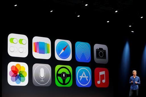 New Apple iOS 7 features are displayed on screen during Apple Worldwide Developers Conference
