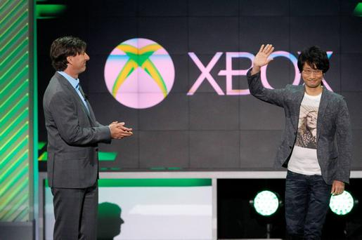 Gaming legend Hideo Kojima (R), creator of Metal Gear Solid, next to Don Mattrick (L), President of Microsoft's Interactive Entertainment Business, as they announce the next chapter of the franchise, Metal Gear Solid 5: The Phantom Pain, during the Xbox E3 Media Briefing at USC's Galen Center in Los Angeles, California