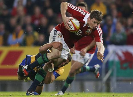 Brian O'Driscoll of the Lions is tackled during the match between Combined Country and the British & Irish Lions