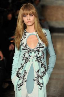 Cara Delevingne walks the runway