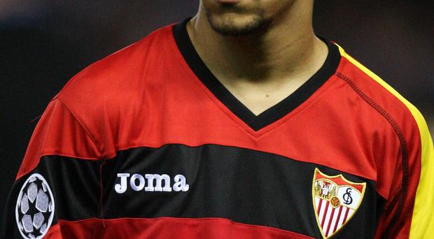Manchester City have confirmed the signing of Spain winger Jesus Navas from Sevilla
