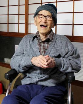 Jiroemon Kimura smiles after he was presented with the certificate of the world's oldest living man in 2012