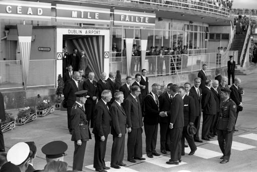 Day One: President John F. Kennedy arrives at Dublin Airport and is introduced to VIPs by Taoiseach Sean Lemass. 26.06.1963 . (NPA and Independent Newspapers Ireland collection)