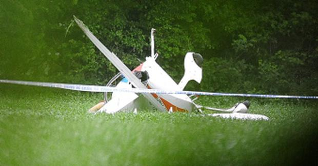 The remains of a light aircraft which crashed in near Crinkle, Birr, Co Offaly. Photograph: James Flynn/APX