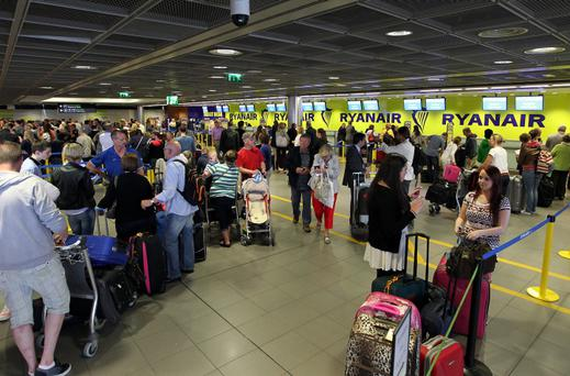 Ryanair Passengers pictured waiting for flight information at Dublin Airport