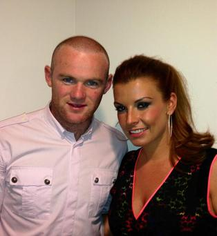 Wayne tweeted this picture with wife Coleen