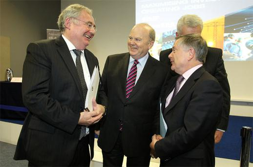 Pat Rabbitte, Michael Noonan and Brendan Howlin after the meda briefing on the update to the NTMA bill at the Grangegorman Development Authority
