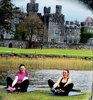 Yoga by the lake at Ashford Castle.