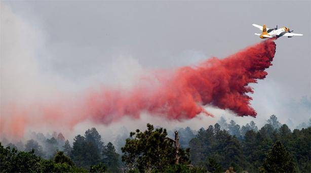 A slurry bomber makes a pass over the Black Forest fire north of Colorado Springs