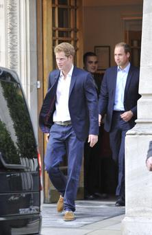 Prince William and Prince Harry leave the London Clinic in central London after visiting the Duke of Edinburgh.