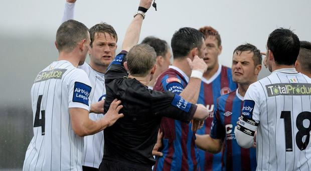 St Patrick Athletic's Killian Brennan is shown a red card by referee Anthony Buttimer
